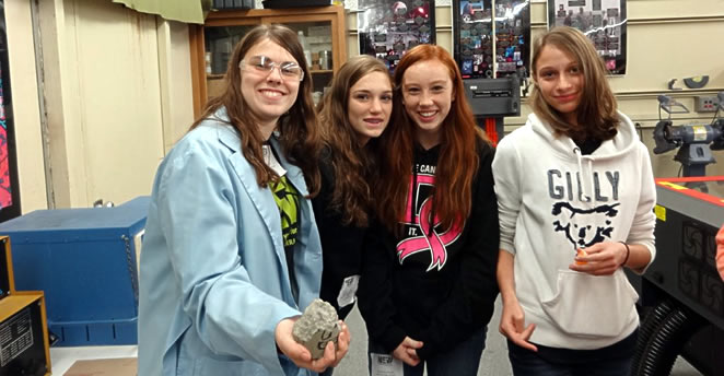 High school girls in Sierra College Engineering lab where they crushed a cement core sample