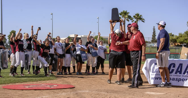 Slide: Hoisting the championship hardware