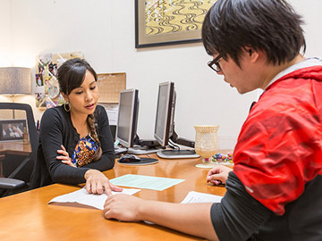 A counselor and student at the counseling office in NCC campus